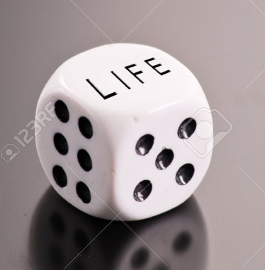 9404386-Rolling-The-Dice-of-Life-Stock-Photo